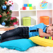 Little boy sleeping under Christmas Tree waiting for Santa Claus to come — Stock Photo #15318273