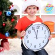 Little boy with clock in anticipation of New Year — Foto Stock #15318351