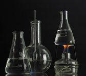 Spiritlamp and test-tubes on blue background — Stock Photo