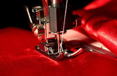 Sewing machine with red cloth closeup — Zdjęcie stockowe