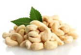 Tasty cashew nuts with leaves, isolated on white — Stock Photo