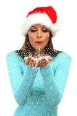 Vacker ung kvinna blåser snö, isolerad på vit — Stockfoto