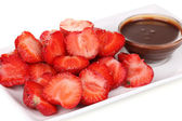 Fresh strawberries on plate with chocolate close-up — Stock Photo