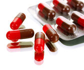 Capsules packed in blisters, isolated on white — Stock Photo
