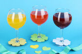 Colorful cocktails with bright decor for glasses on blue background — Stock Photo