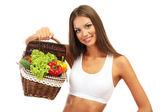 Vacker ung kvinna med grönsaker i korg, isolerad på vit — Stockfoto