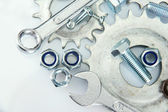 Machine gear, metal cogwheels, nuts and bolts isolated on white — Stock Photo