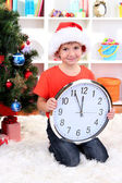 Little boy with clock in anticipation of New Year — Стоковое фото