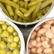 Stock Photo: Open tin cans of french bean, beans and peas isolated on white