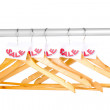 Wooden clothes hangers as sale symbol isolated on white — Stock Photo #15513681