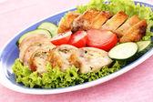Tasty meat cutlet with garnish on plate — Stock Photo