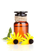 Medicine bottle and flowers isolated on white — Stock Photo