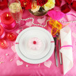 Table setting in honor of Valentine's Day close-up - Stock Photo
