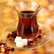 Glass of Turkish tea on color background — ストック写真