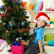 Little girl decorating christmas tree — Stock Photo #15529301