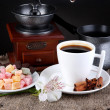 White cup of Turkish coffee with rahat delight, coffee pot and coffee mill on wooden table - 图库照片