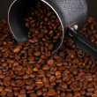 Stock Photo: Coffee beans poured from turk