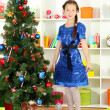 Stock Photo: Little girl waiting her christmas gifts