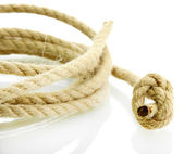 Roll of rope with knot, isolated on white — Stock fotografie