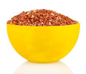 Red rice in a yellow plate , isolated on white — Stock Photo