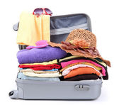 Open silver suitcase with clothing isolated on white — Stock Photo