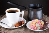 White cup of Turkish coffee with rahat delight and coffee maker on wooden table — Stock Photo