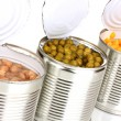 Stock Photo: Open tin cans of corn, beans and peas isolated on white