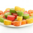 Colorful jelly candies on plate isolated on white — Stock Photo #15631233