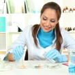 Young scientist with Petri dish in  laboratory — Stock Photo #15634489