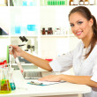 Young female scientist in laboratory — Stock Photo #15634507