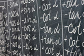 Math formulas written on the desk — Stock Photo