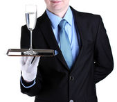 Formal waiter with a glass of water on silver tray isolated on white — Stock Photo