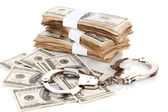 Handcuffs and packs of dollars isolated on white — 图库照片