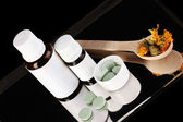 Alternative therapies on the tray on black background close-up — Stockfoto