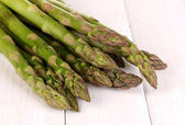 Fresh asparagus on white wooden table background — Stock Photo
