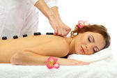 Beautiful young woman in spa salon getting massage with spa stones — Stock Photo