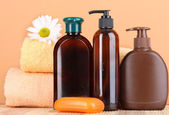 Set for care of a body on peach background — Stock Photo