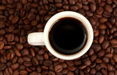 Cup of coffee on brown background — Stock Photo