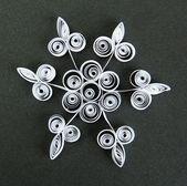 Beautiful paper snowflake, on black background — Stock Photo