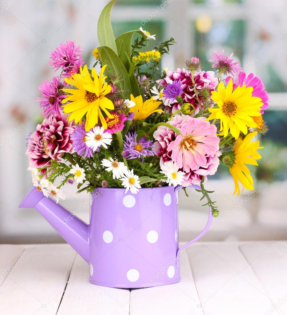 beautiful bouquet of bright flowers in watering can on. Black Bedroom Furniture Sets. Home Design Ideas
