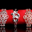 Three elegant bracelets on the red cloth on black background — Stockfoto