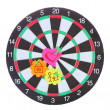 Stock Photo: Darts with stickers depicting the life values isolated on white. The darts hit the target.