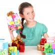 Stock Photo: Little girl with gifts isolated on white