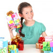 Little girl with gifts isolated on white — Stock Photo #15666177