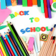 The words 'Back to School' composed of letters with various school supplies close-up isolated on white — Stok fotoğraf