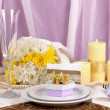 Serving fabulous wedding table in purple and gold color on white and purple fabric background — Stock Photo #15668421