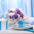 Serving fabulous wedding table in blue color on blue and white fabric background — Stock Photo