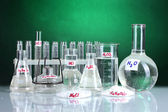 Test-tubes with various acids and chemicals on bright background — Stockfoto