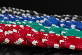 Casino chips close-up isolated on black — Stock Photo