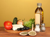 Ingredients for a Greek salad on brown background close-up — Stock Photo